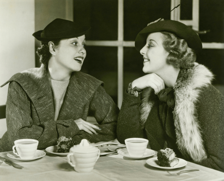 old fashioned ladies eating cake